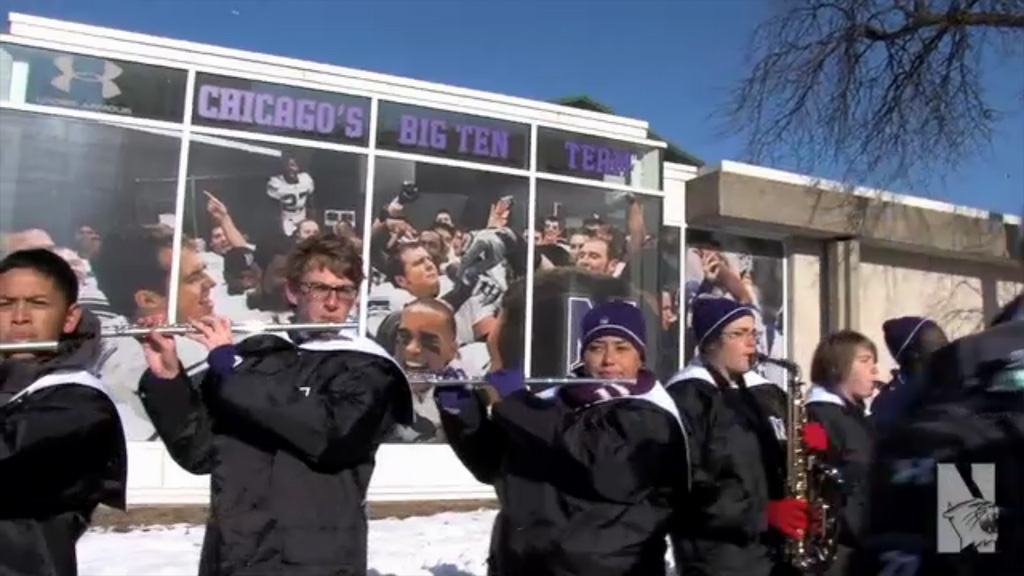 NUMB Welcomes the Northwestern football team home from the Gator Bowl. (Video image from NUsports.com)